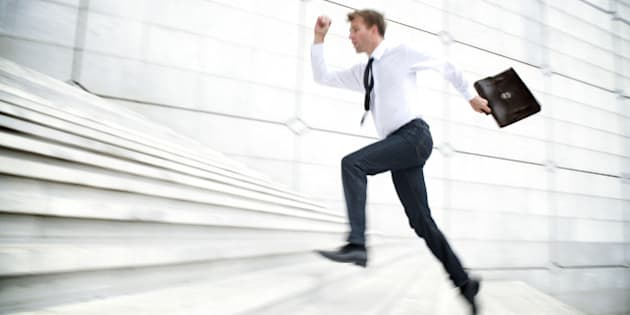 Motion Blur Office Worker Leaps Up White Staircase