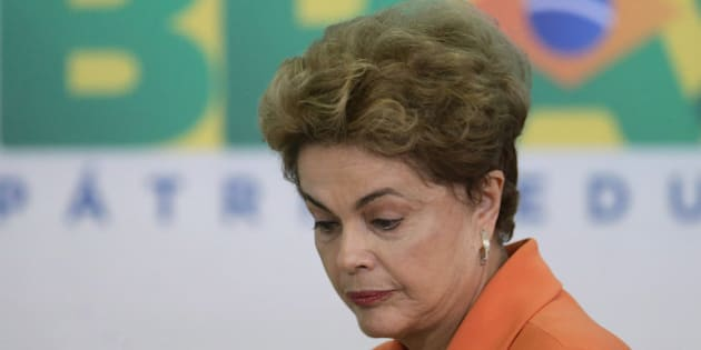 Brazil's President Dilma Rousseff arrives for a ceremony in Planalto presidential palace to launch an agricultural plan that allocates billions of dollars to farmers in Braslia, Brazil, Wednesday, May 4, 2016. Brazil's attorney general has asked the country's highest court to authorize an investigation into embattled Rousseff over obstruction of justice allegations, according to major Brazilian news organizations. (AP Photo/Eraldo Peres)