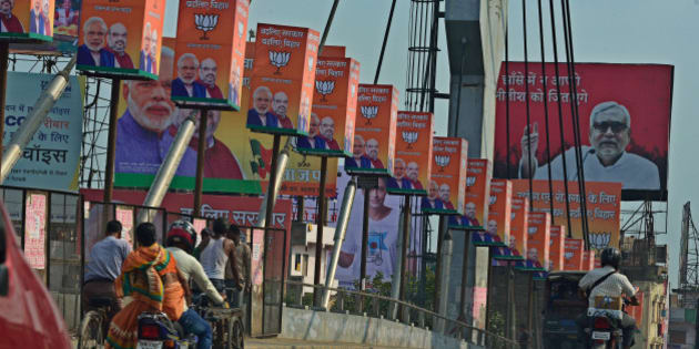 PATNA, INDIA - OCTOBER 13: Posters of Prime Minister Narendra Modi and Bihar Chief Minister Nitish Kumar are spread all across main roads of the city during phase 3 of Bihar Assembly Elections on October 13, 2015 in Patna, India. (Photo by Pradeep Gaur/Mint via Getty Images)