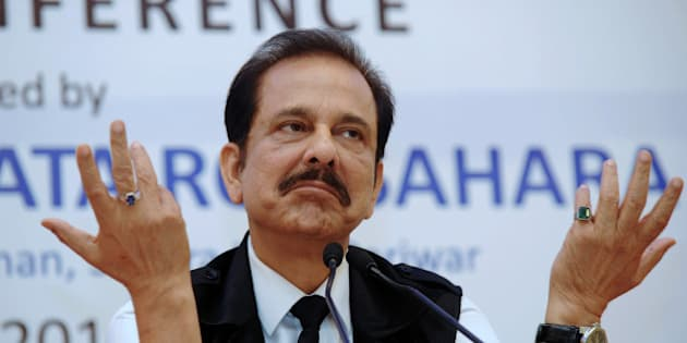 Chairman of India's Sahara Group Subrata Roy gestures as he addresses a press conference in Kolkata on November 29, 2013.  An Indian regulator froze the bank accounts of two companies of the giant Sahara group in February 2013, after it failed to obey a court order to repay billions of dollars illegally collected from investors. Sahara, a household name in India and sponsor of the national cricket team, raised 240 billion rupees ($4.4 billion) in illegal bond sales to 30 million small investors between 2008 and 2011.  AFP PHOTO/Dibyangshu SARKAR        (Photo credit should read DIBYANGSHU SARKAR/AFP/Getty Images)