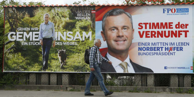 "A man passes presidential election campaign posters of Alexander Van der Bellen, supported by the Greens, reading ""Let's walk part of the way together"" and Norbert Hofer, supported by the FPOe, reading ""The voice of reason"" in Vienna, Austria, May 11, 2016. REUTERS/Heinz-Peter Bader"