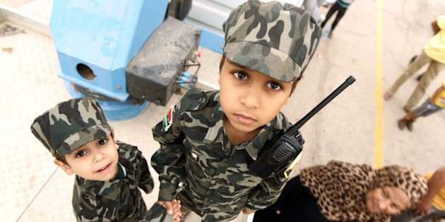 Libyan children dressed in military fatigues attend a demonstration in the eastern coastal city of Benghazi calling for military forces to re-capture the southern city of Sirte from the Islamic State (IS) group without foreign intervention on May 6, 2016. The head of Libya's unity government announced plans the previous month for a concerted campaign to drive the Islamic State group out of the North African country, but without foreign intervention. The unity government fears that separate operations in Sirte could spark clashes between the multitude of different fighting forces in Libya and play into the jihadists' hands.   / AFP / ABDULLAH DOMA        (Photo credit should read ABDULLAH DOMA/AFP/Getty Images)
