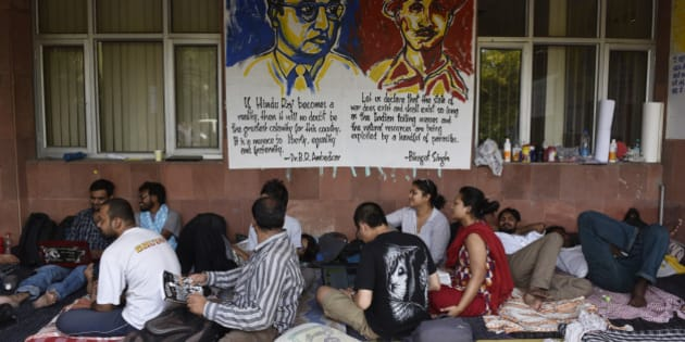 NEW DELHI, INDIA - MAY 3: JNU students on day six of hunger strike protesting punishment given to them by the university authorities on May 3, 2016 in New Delhi, India. Representatives of both factions are sitting on a hunger strike. Students with Left affiliations are on a hunger strike protesting punishment given to them by the university authorities for the February 9 event held to commemorate Parliament attack convict Afzal Guru. Anti-national slogans were allegedly raised at the event. Students of the ABVP faction are on a hunger strike demanding the punishment against students be made more stringent. (Photo by Vipin Kumar/Hindustan Times via Getty Images)