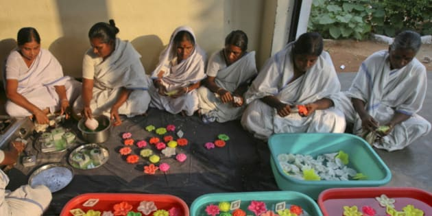 Women inmates prepare scented floating wax candles inside Chanchalguda Women Prison for the Hindu festival of Diwali in the Southern Indian city of Hyderabad October 24, 2011. Jail authorities have initiated many programs like baking, tailoring and candle making for inmates to upgrade their work skills and prepare them for the responsibilities of life after prison, the director general of prisons CN Gopinath Reddy said. The prisoners can earn about 50 Indian Rupees ($1) for eight hours of work, he added. REUTERS/Krishnendu Halder (INDIA - Tags: RELIGION SOCIETY BUSINESS)