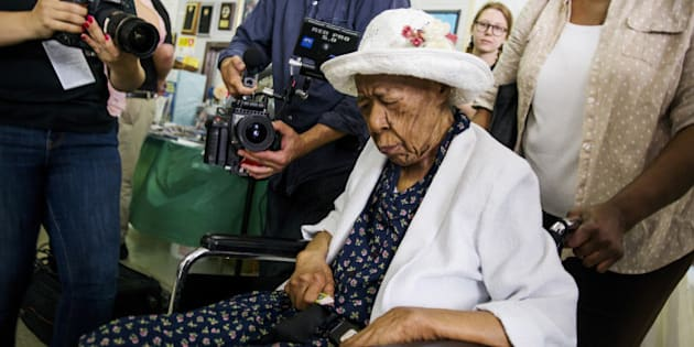 "Susannah Mushatt Jones (C), known as ""Miss Susie"" is wheeled into a celebration for her 116th birthday with family members, local dignitaries, and friends in the Brooklyn borough of New York, July 7, 2015. REUTERS/Lucas Jackson/File Photo"
