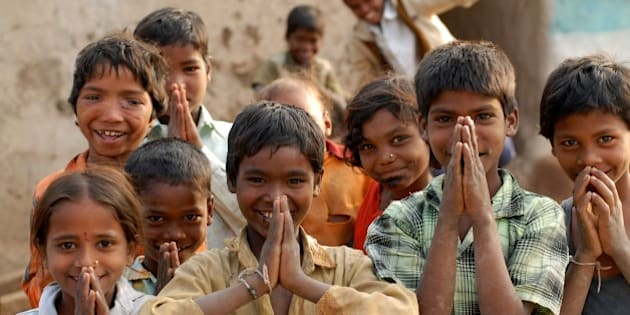India: Children in a village near Nagpur, Maharashtra, doing 'Namaste' which is a form of welcome or greeting. Jan 29, 2007. (Photo by: Majority World/UIG via Getty Images)