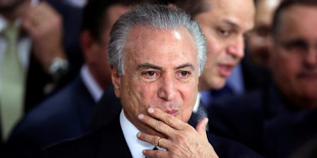 Brazil's interim President Michel Temer gestures during a ceremony where he made his first public remarks after the Brazilian Senate voted to impeach President Dilma Rousseff at the Planalto Palace in Brasilia, Brazil, May 12, 2016. REUTERS/Ueslei Marcelino