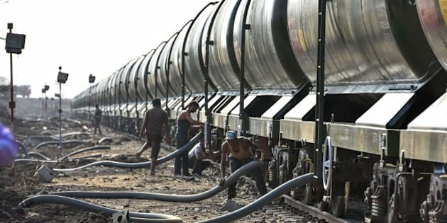 LATUR, INDIA - APRIL 22: Special train carrying around 2.5MLD of water arrives in parched Latur district in Marathwada on April 22, 2016 in Latur, India. Even as the eleventh water-bearing train chugged into Latur station on Friday, bringing in 25 lakh litres of water in its 50 wagons, it was clear that the thirst felt by this city cannot be quenched with just this much. So far, the 11 trains - nine with 10 wagons and two with 50 wagons - have supplied 95 lakh litres of water to the city. That is at least 100 lakh litres less than what Latur, a city of five lakh, needs daily (around 220 to 250 lakh litres). This 35 lakh litres used by the city daily now is less than the daily water used by just 11 breweries and distilleries (45 lakh litres), 300 km away near Aurangabad, Marathwadas most industrialised city. (Photo by Satish Bate/Hindustan Times via Getty Images)