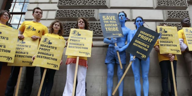 Demonstrators, including a pair dressed as characters from the film Avatar, protest against British mining company Vedanta Resources during their Annual General Meeting in London July 28, 2010. India-focused Vedanta Resources faced protests at its shareholders' meeting on Wednesday from investors and pressure groups over its plans to build a bauxite mine in India's eastern Orissa state, in an area sacred to indigenous people. REUTERS/Stefan Wermuth (BRITAIN - Tags: POLITICS ENERGY SOCIETY BUSINESS)