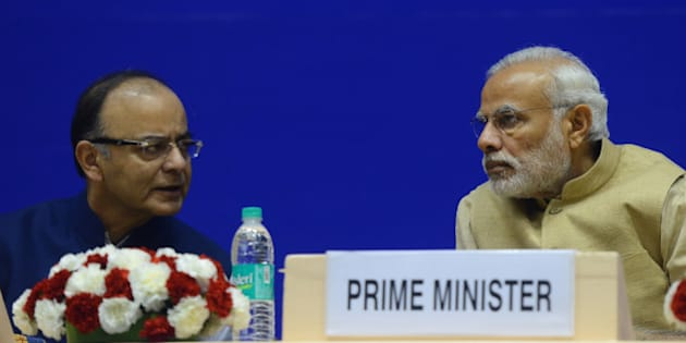 NEW DELHI, INDIA OCTOBER 16: Prime Minister Narendra Modi with Finance Minister Arun Jaitley at the inauguration of the 10th Annual Convention of Central Information Commission, in New Delhi.(Photo by Praveen Negi/India Today Group/Getty Images)