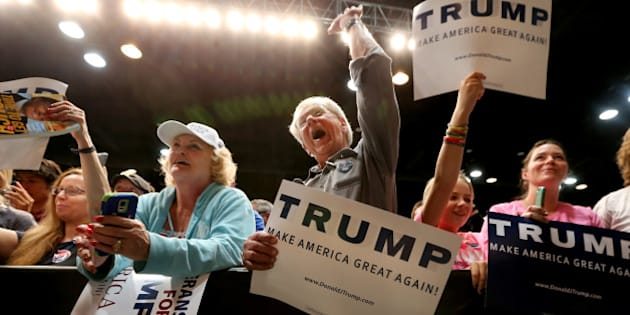 Donald Trump supporters listen to U.S. Republican presidential candidate Donald Trump speak at a campaign rally in Spokane, Washington, U.S., May 7, 2016. REUTERS/Jake Parrish