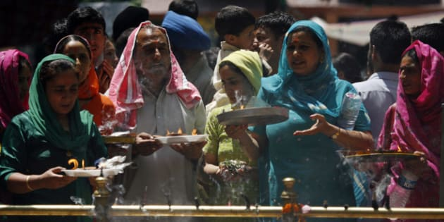 Kashmiri Hindus, or Pandits, pray during an annual festival at a shrine in Khirbhawani, 30 km (19 miles) east of Srinagar June 11, 2008. Every year thousands of displaced Kashmiri Hindus, known as Pandits in Kashmir, gather at the holy shrine in the restive Indian state of Jammu and Kashmir to pray for peace and their early return home. More than 200,000 Hindus fled their homes when an armed rebellion broke out in the Himalayan region at the end of 1989. REUTERS/Fayaz Kabli (INDIAN ADMINISTERED KASHMIR)