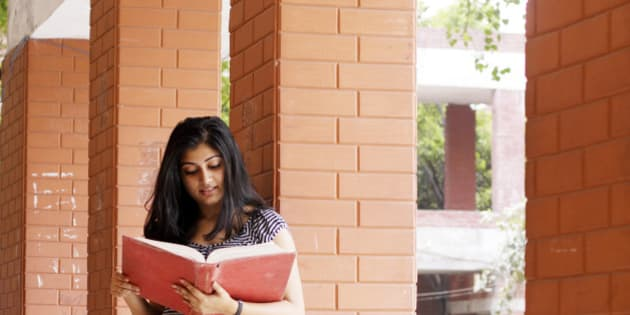 An Indian Student reading a book