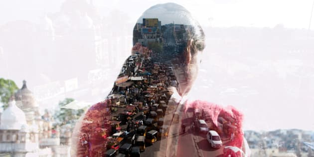 double exposure of a woman and Indian cityscape