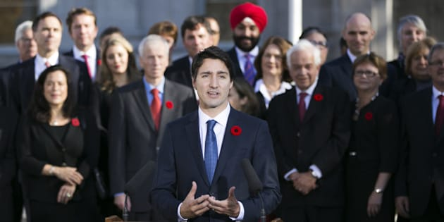OTTAWA, Nov. 4, 2015-- Newly elected Canadian Prime Minister Justin Trudeau, front, delivers a statement after his swearing in ceremony at Rideau Hall in Ottawa, Canada, Nov. 4, 2015. Justin Trudeau was sworn in as Canada's 23rd prime minister and named a 31-member cabinet here Wednesday. (Xinhua/Chris Roussakis via Getty Images)