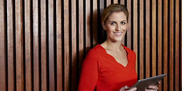 Business woman holding a digital tablet.