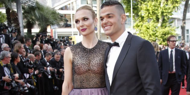 """Soccer player Hatem Ben Arfa (R) poses on the red carpet as he arrives for the screening of film """"Loving"""" in competition at the 69th Cannes Film Festival in Cannes, France, May 16, 2016.        REUTERS/Jean-Paul Pelissier"""