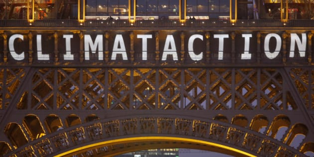 "The slogan ""Climate action"" is projected on the Eiffel Tower as part of the World Climate Change Conference 2015 (COP21) in Paris, France, December 11, 2015.   REUTERS/Charles Platiau"