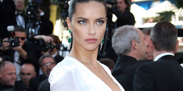 Model Adriana Lima poses for photographers upon arrival at the screening of the film Julieta at the 69th international film festival, Cannes, southern France, Tuesday, May 17, 2016. (AP Photo/Joel Ryan)