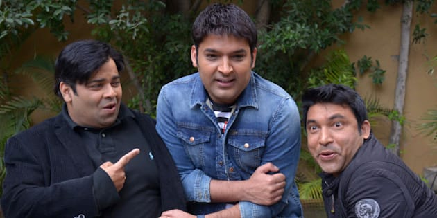 Indian stand-up comedians and Bollywood actors Kapil Sharma (C) Chandan Prabhakar (R) Kiku Sharda(L)share a light moment during  a promotional event for the forthcoming  comedy show 'The  Kapil Sharma Show ' in Amritsar on March 5, 2016. / AFP / NARINDER NANU        (Photo credit should read NARINDER NANU/AFP/Getty Images)