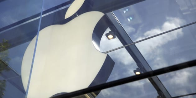 The Apple logo is seen atop the Apple Store Thursday, March 31, 2016, in Palo Alto, Calif.  (AP Photo/Eric Risberg)