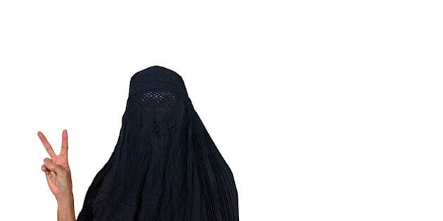 Woman in a burka making a peace sign