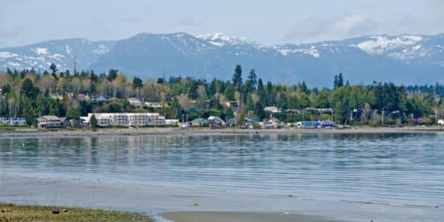 Looking across Qualicum Bay towards Qualicum Beach on Vancouver Island. A tourism and retirees destination.