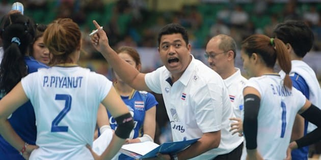 TIANJIN, CHINA - MAY 27:  (CHINA OUT) Kiattipong Radchatagriengkai, head coach of Thailand, speaks to players in the semi-finals on day eight of the 18th Asian Sr. Women's Volleyball Championship at Tianjin Olympic Center Stadium on May 27, 2015 in Tianjin, China.  (Photo by VCG/VCG via Getty Images)