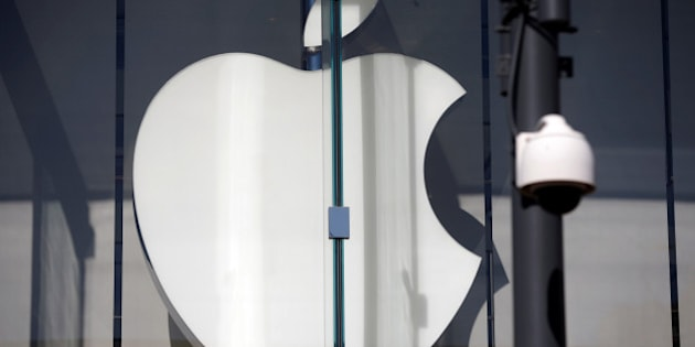 The logo of Dow Jones Industrial Average stock market index listed company Apple (AAPL) is seen next to a security camera in Santa Monica, California, United States, April 12, 2016. REUTERS/Lucy Nicholson
