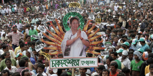 "Indian West Bengal state's Trinamool Congress party (TMC) supporters carry a cutout of their leader and state chief minister Mamata Banerjee comparing her with Hindu Goddess Durga with development schemes displayed on each hand, during an event in Kolkata, India, Tuesday, July 21, 2015. The event was held in memory of fourteen Congress party supporters who were killed in police firing during an agitation against the then ruling Left Front government on this day in 1993, described by the West Bengal state as Martyr's Day. The TMC was founded in 1998 after it broke away from the Congress party. Poster reads, ""Development is going on with the golden hands of beloved leader Mamata Banerjee in our golden West Bengal state"". (AP Photo/Bikas Das)"