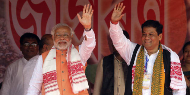 India's main opposition Bharatiya Janata Party (BJP) prime ministerial candidate Narendra Modi, left, and the party's Assam state President Sarbananda Sonowal wave to the crowd during an election campaign rally in Nagaon, in the northeastern Indian state of Assam, Saturday, April 19, 2014. As India, Asia's third-largest economy, holds elections that will gauge the mood of millions of new voters, Modi's Hindu nationalist party is proclaiming the economic success of Gujarat, the western state he's led for more than decade. Critics, however, question whether the extra wealth has translated into better lives for the state's 60 million people. (AP Photo/Anupam Nath)