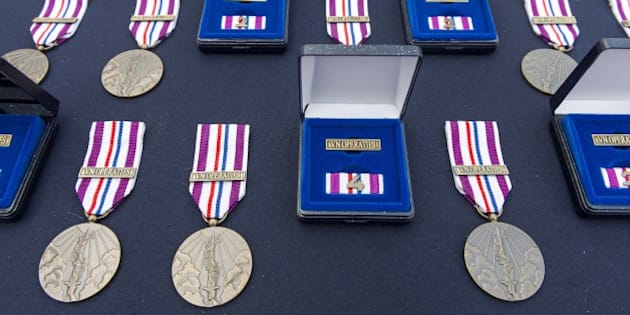 Commemorative peace operation medals, awarded to soldiers of the Royal Netherlands Army for their contribution to the United Nations (UN) mission in Mali, are pictured ahead of an awarding ceremony at the Van Braam Houckgeest station in Doorn, The Netherlands, on September 25, 2015. AFP / ANP / LEX VAN LIESHOUT +++ NETHERLANDS OUT        (Photo credit should read LEX VAN LIESHOUT/AFP/Getty Images)