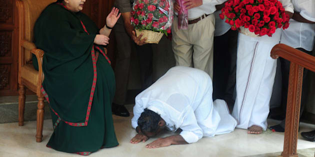 A party cadre prostrates himself at the feet of All India Anna Dravida Munnetra Kazhagam(AIADMK) leader Jayalalithaa Jayaram as she gestures at her residence in Chennai on May 19, 2016.  The makeup of India's next government could lie in the hands of a trio of women who command a massive following in their regional heartlands, including a populist former movie star known as 'Mother' to supporters. / AFP / ARUN SANKAR        (Photo credit should read ARUN SANKAR/AFP/Getty Images)