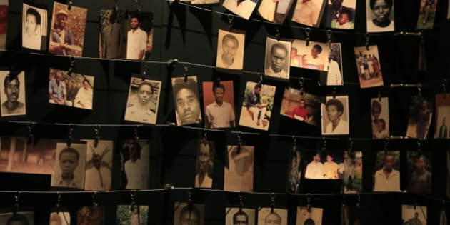 Photographs of people who were killed during the 1994 genocide are seen inside the Kigali Genocide Memorial Museum as the country prepares to commemorate the 20th anniversary of the genocide in the Rwandan capital Kigali April 5, 2014. An estimated 800,000 people were killed in 100 days during the genocide. REUTERS/Noor Khamis (RWANDA - Tags: ANNIVERSARY POLITICS)