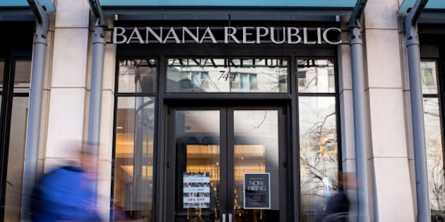 Pedestrians walk past a Banana Republic LLC store in Chicago, Illinois, U.S., on Friday, Feb. 19, 2016. The Gap Inc. is scheduled to release earnings figures on February 24. Photographer: Christopher Dilts/Bloomberg via Getty Images