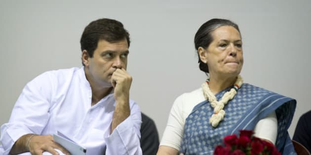 Congress party President Sonia Gandhi, right, and her son and Vice President Rahul Gandhi listen to a speaker during celebrations marking the 125th birth anniversary of the first Indian Prime Minister Jawaharlal Nehru in New Delhi, India, Thursday, Nov. 13, 2014.  Nehru is the great-grandfather of Rahul Gandhi. His birth anniversary falls on Nov. 14. (AP Photo/Saurabh Das)