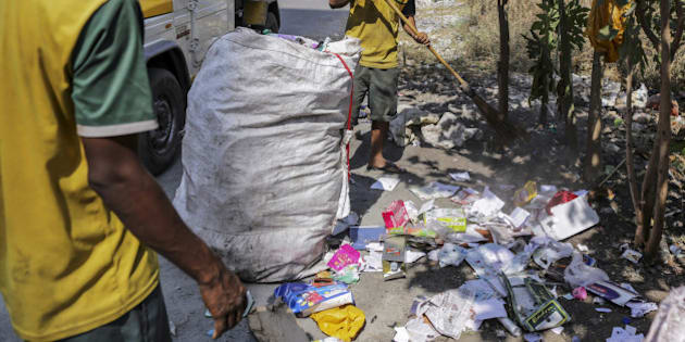 A clean up team for the Flying Debris Squad of the Navi Mumbai Municipal Corporation (NMMC), collect garbage dumped on the side of a road in Navi Mumbai, Maharashtra, India, on Tuesday, Feb. 2, 2016. Some of India's major municipalities are putting in place anti-garbage programs using smartphone technology to try to vanquish India's Sisyphean waste problems and ubiquitous trouble with litter. Photographer: Dhiraj Singh/Bloomberg via Getty Images