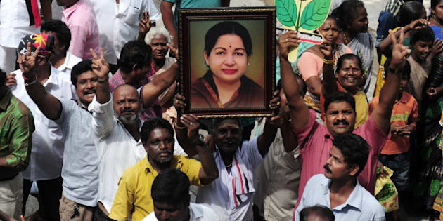 Members of the All India Anna Dravida Munnetra Kazhagam(AIADMK) party carry placards with  the image of AIADMK leader Jayalalithaa Jayaram as they celebrate in front of her residence in Chennai on May 19, 2016. The makeup of India's next government could lie in the hands of a trio of women who command a massive following in their regional heartlands, including a populist former movie star known as 'Mother' to supporters. / AFP / ARUN SANKAR        (Photo credit should read ARUN SANKAR/AFP/Getty Images)