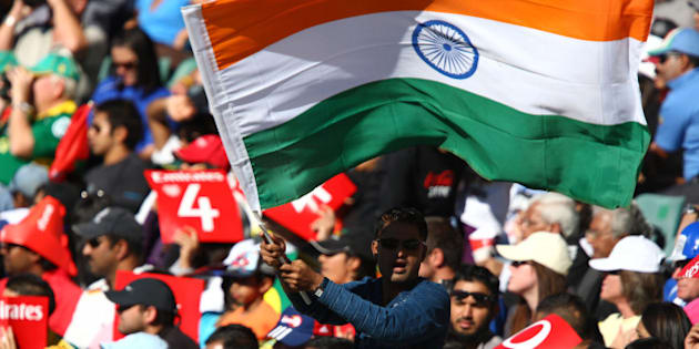 A cricket fan waves an Indian flag during the 2009 Indian Premier League (IPL) T20 cricket match between the Kings XI Punjab and the Deccan Chargers in Johannesburg May 17, 2009. REUTERS/Siphiwe Sibeko (SOUTH AFRICA SPORT CRICKET)