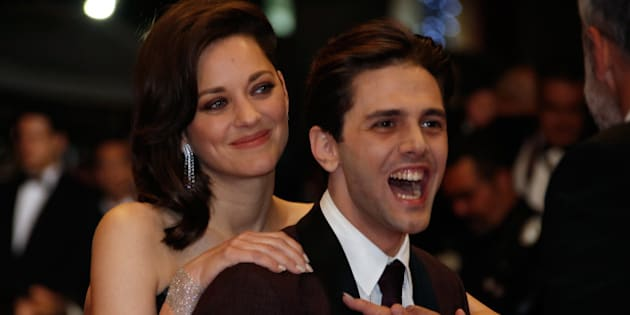 """Director Xavier Dolan and cast member Marion Cotillard pose on the red carpet as they arrive for the screening of the film """"Juste la fin du monde"""" (It's Only the End of the World) in competition at the 69th Cannes Film Festival , France, May 19, 2016.            REUTERS/Eric Gaillard"""