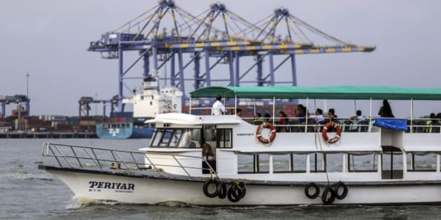 A ferry travels past the Kochi International Container Transhipment Terminal (ICTT), operated by DP World Ltd., in Cochin, India, on Friday, May 29, 2015. India is gearing up for a deficient monsoon for a second year, signaling record food imports, efforts to cushion farmers and contingencies for lower hydroelectricity. Photographer: Dhiraj Singh/Bloomberg via Getty Images