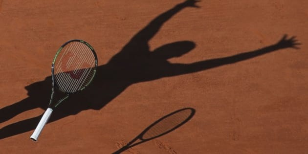 FILE - In this Saturday June 6, 2015 file photo, Serena Williams of the U.S. casts a shadow on the clay as she drops her racket and celebrates winning the final of the French Open tennis tournament against Lucie Safarova of the Czech Republic in three sets, 6-3, 6-7, 6-2, at the Roland Garros stadium, in Paris, France. (AP Photo/David Vincent, file)
