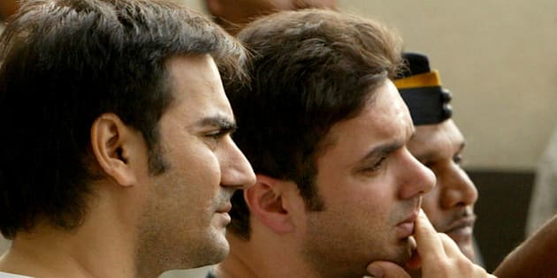 Brothers of Bollywood star Salman Khan and actors Arbaaz Khan, left, and Sohail Khan, center, look on as Salman Khan's lawyer Dipesh Mehta, unseen, speaks to journalists at Salman's residence in Mumbai, India, Friday, Aug. 24, 2007. An Indian court upheld Khan's conviction for poaching a rare buck in a wildlife preserve, rejecting the actor's appeal and ordering him to start serving his five-year prison sentence, lawyers said. (AP Photo/Gautam Singh)