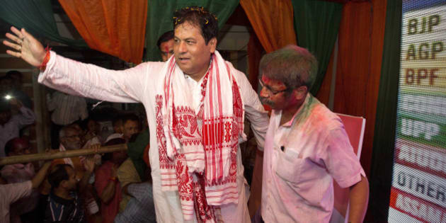 Bharatiya Janata Party, (BJP) leader Sarbanada Sonowal, center, waves to his supporters after party won state assembly elections in Gauhati, India , Thursday, May 19, 2016. India's ruling Hindu nationalist party made dramatic gains in elections in the eastern state of Assam but trailed in four other states, the election commission said Thursday. Local parties dominated the results in West Bengal, Tamil Nadu and Kerala states, while the Congress won in Pondicherry. (AP Photo/ Anupam Nath)