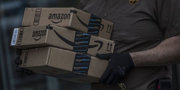 A United Parcel Service Inc. (UPS) delivery driver carrries Amazon.com Inc. packages near the Fulton Street Mall in the Brooklyn borough of New York, U.S, on Friday, May 13, 2016. Consumer confidence fell last week to a five-month low as Americans became more downbeat about the economy, Bloomberg Consumer Comfort data showed Thursday. Photographer: Victor J. Blue/Bloomberg via Getty Images