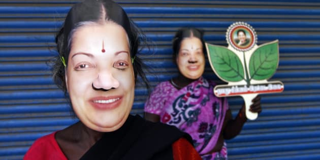 Supporters of J. Jayalalithaa, chief minister of India's Tamil Nadu state and chief of Anna Dravida Munetra Khazhgam (AIADMK), wear masks and hold her party's symbol during an election campaign ahead of the general elections in the southern Indian city of Chennai March 21, 2014. The politics of forming India's next government could come down to how many seats a 1960s matinee siren can wrest from a rival named Stalin in Tamil Nadu. Picture taken March 21, 2014. REUTERS/Babu (INDIA - Tags: POLITICS ELECTIONS)