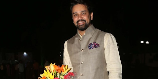NEW DELHI, INDIA - APRIL 4: BCCI secretary Anurag Thakur during a party hosted to congratulate singer Malini Awasthi on her recent Padma honour, at BSF Officers Mess Lawn, Nizamuddin on April 4, 2016 in New Delhi, India. The evening began with Awadhi folk song and dance performance followed by singer Sunanda Sharma's soulful semi-classical performance. Apart from enjoying the performances, the guests were heard discussing the soaring Delhi heat and the Panama Papers. (Photo by Prabhas Roy/Hindustan Times via Getty Images)