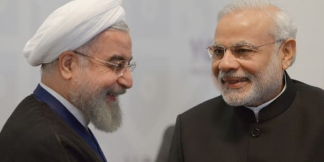 Iran's President Hassan Rouhani, left, smiles as Indian Prime Minister Narendra Modi speaks to him during the summit in Ufa, Russia, Thursday, July 9, 2015. Ufa hosts SOC (Shanghai Cooperation Organization) and BRICS (Brazil, Russia, India, China and South Africa) summits. (Host photo agency/RIA Novosti Pool Photo via AP)