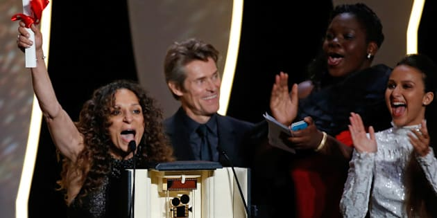 """Director Houda Benyamina, Camera d'Or award winner for her film """"Divines"""", reacts on stage during the closing ceremony of the 69th Cannes Film Festival in Cannes, France, May 22, 2016.     REUTERS/Eric Gaillard"""