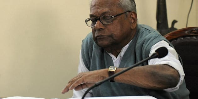 Kerala Chief Minister V.S. Achuthanandan reads a document during the Communist Party of India (Marxist) Polit Bureau meeting in New Delhi on February 14, 2009. The Congress in Kerala said the party expected that the ongoing meeting of the CPI(M) Polit Bureau in New Delhi would take an appropriate decision on the SNC Lavalin issue.  Kerala Pradesh Congress Committee (KPCC) president Ramesh Chennithala, who was leading a statewide 'Kerala Raksha' march, said the Polit Bureau would take a reasonable decision on the CBI request seeking the nod of the Kerala government for prosecution of the accused, including CPI(M) State Secretary Pinarayi Vijayan. AFP PHOTO/ Prakash SINGH (Photo credit should read PRAKASH SINGH/AFP/Getty Images)